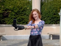 Artists create imaginary-friend Selfie Arm for lone travelers