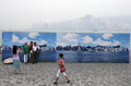 Billboards offer tourists a glimpse of smog-free Hong Kong