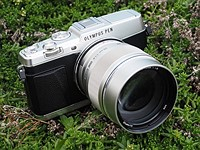 Does the new Olympus PEN E-P5 firmware reduce image shake?