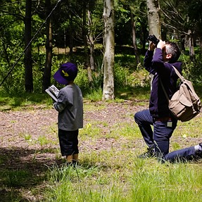 Walk in the park - Bird watcher with guide