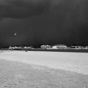 Black Storm Clouds By The Sea